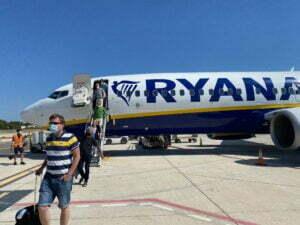 Passengers disembarking from a Ryanair Boeing.